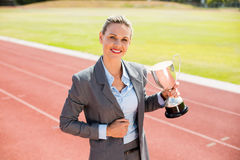 Portrait of happy businesswoman holding a trophy Royalty Free Stock Images