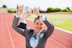 Portrait of happy businesswoman holding up a trophy Royalty Free Stock Photos