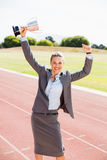 Portrait of happy businesswoman holding up a trophy Stock Images