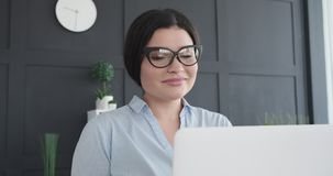 Businesswoman with laptop at office. Portrait of happy businesswoman with laptop at office stock footage