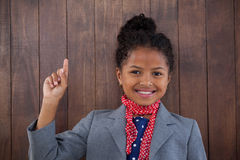 Portrait of happy businesswoman pointing upwards Stock Images