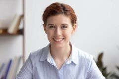 Portrait of happy businesswoman professional manager looking at camera stock photography