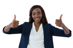 Portrait of happy businesswoman showing thumbs up Stock Image