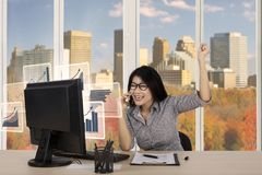 Happy businesswoman with graph on monitor Royalty Free Stock Photo