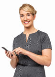 Portrait Of Happy Businesswoman Using Smart Phone Stock Photography