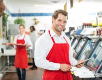 Portrait Of Happy Butcher Holding Digital Tablet Stock Photos