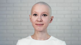 Portrait of a happy cancer survivor woman smiling and looking into the camera. Stock footage of Portrati of a happy cancer survivor woman smiling and looking stock footage