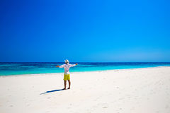 Portrait of a happy carefree man smiling with arms open outdoors. Portrait, human enjoying life on tropical freedom beach. Success. Enjoyment Royalty Free Stock Photography