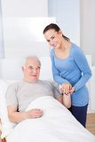 Portrait of happy caregiver with senior man royalty free stock photos