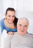 Portrait Of Happy Caregiver With Senior Man Stock Photo