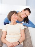 Portrait Of Happy Caregiver With Senior Woman Stock Photography