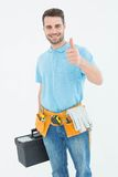 Portrait of happy carpenter gesturing thumbs up Royalty Free Stock Image
