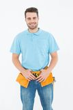 Portrait of happy carpenter wearing tool belt Stock Photo