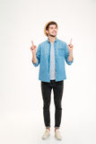Portrait of a happy casual man pointing fingers away Royalty Free Stock Photography
