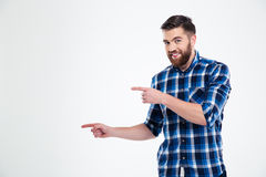 Portrait of a happy casual man pointing fingers away stock images