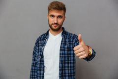 Portrait of a happy casual man showing thumb up Stock Photography