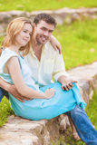 Portrait of happy caucasian Couple Sitting Together Outdoors Whi Stock Photography