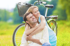 Portrait of Happy Caucasian Couple Sitting Together Outdoors Wit Stock Images