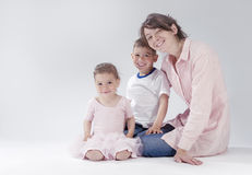 Portrait of Happy Caucasian Family of Three Together Stock Photo