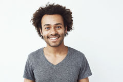 Portrait of happy and charming african guy smiling at camera, a boyfriend waiting for a date, or a head hunter dream Stock Images