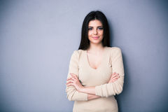 Portrait of a happy charming woman with arms folded Royalty Free Stock Images