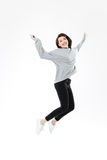 Portrait of a happy cheerful girl jumping and celebrating success Stock Photo
