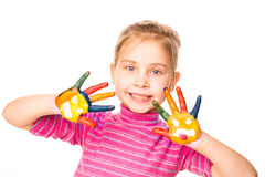 Portrait of a happy cheerful girl showing her hands painted in bright colors Stock Photos