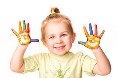 Portrait of a happy cheerful girl showing her hands painted in bright colors Stock Images