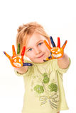 Portrait of a happy cheerful girl showing her hands painted in bright colors Royalty Free Stock Images