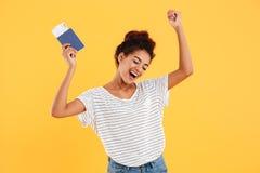 Portrait of happy cheerful holding international passport isolated Stock Photography