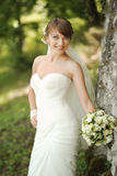Portrait of happy cheerful smiling bride outdoors Stock Photography