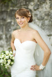 Portrait of happy cheerful smiling bride outdoors Royalty Free Stock Photo