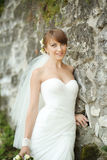 Portrait of happy cheerful smiling bride outdoors Royalty Free Stock Image