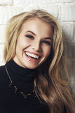 Portrait of happy cheerful smiling young beautiful blond woman Stock Photo
