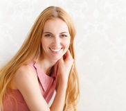 Portrait of happy cheerful smiling young beautiful blond woman Stock Images