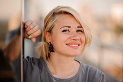 Portrait of happy cheerful smiling young beautiful blond woman, Stock Images