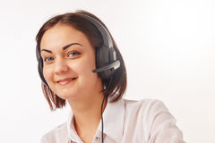 Portrait of happy cheerful support phone operator in headset. Portrait of happy smiling cheerful support phone operator in headset Royalty Free Stock Photo