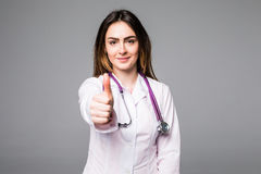 Portrait of happy cheerful toothy doc gesturing like on grey Stock Image