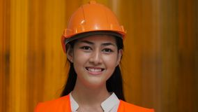 Portrait of happy and cheerful woman engineer looking at the camera.