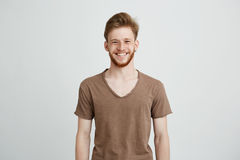 Portrait of happy cheerful young man with beard smiling looking at camera over white background. Royalty Free Stock Photography