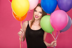 Portrait of happy cheerful young woman with colorful balloons Stock Image