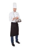 Portrait of happy chef holding tray Royalty Free Stock Photo