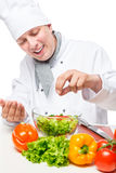 Portrait of a happy chef salad sprinkled stock photo