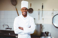 Portrait of happy chef standing with arms crossed. In commercial kitchen royalty free stock photo