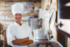 Portrait of happy chef standing with arms crossed. In commercial kitchen royalty free stock photos