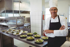 Portrait of happy chef with standing with arms crossed at order station. In restaurant royalty free stock photos