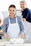 Portrait Of Happy Chefs Preparing Pasta At Kitchen Royalty Free Stock Photos