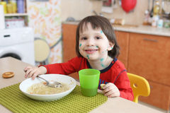 Portrait of happy child with chicken pox eats soup Royalty Free Stock Photography