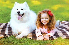 Portrait happy child and dog having fun Stock Photography