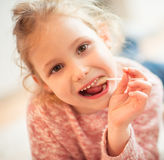 Portrait of happy child girl with lolipop in her hand Royalty Free Stock Photography